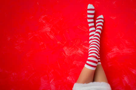 pies sexis: Woman in funny socks Foto de archivo