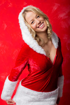 winter holiday: Happy woman in Santa costume smiling