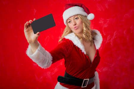 love pic: Woman dressed in Santa costume taking selfie with smart phone