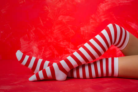 Woman in red and white striped socks