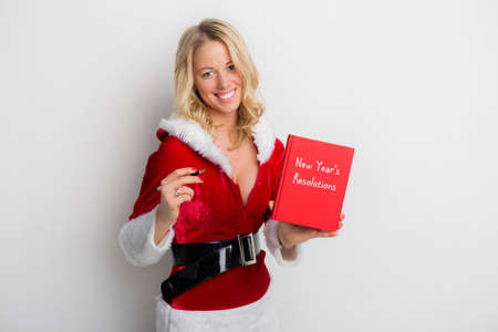 new years resolution: Woman holding New Years resolution book Stock Photo