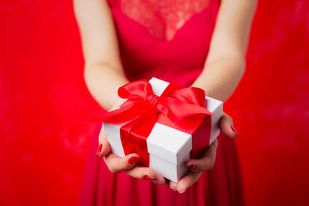 christmas spirit: Woman holding Christmas present