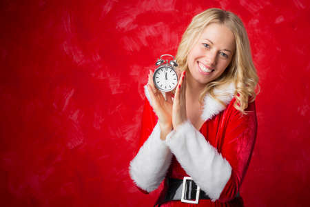 sexy female: Happy woman holding a clock
