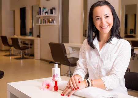 manicurist: Happy woman after visiting manicure Stock Photo