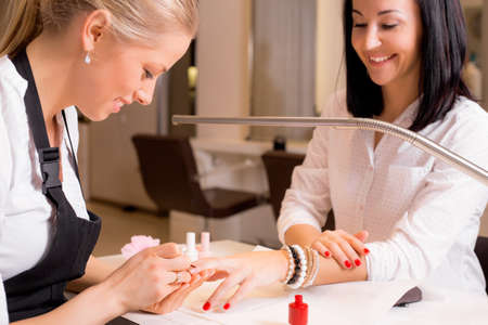 manicurist: Happy women doing manicure Stock Photo