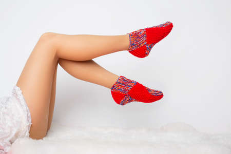 ground: Womans legs in funny socks