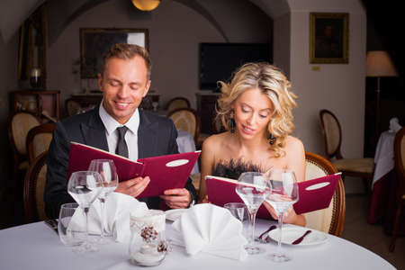 what to eat: Couple choosing what to eat at restaurant