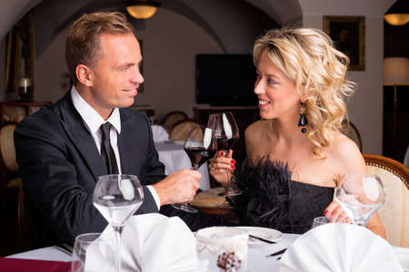 wine and dine: Couple having a celebration in restaurant