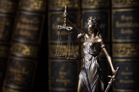 justice: Themis figure in library Stock Photo