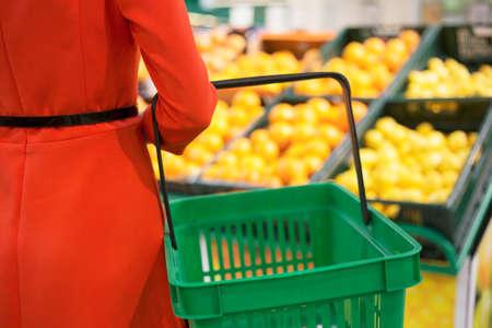 food basket: Woman in market with item basket