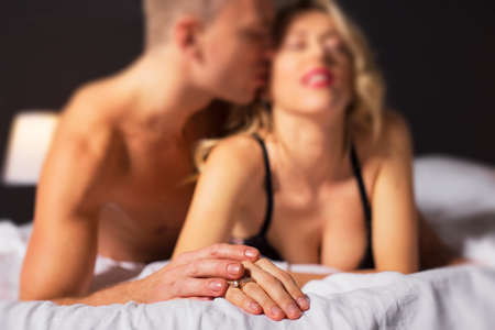 man and woman sex: Sensual couple in bedroom Stock Photo