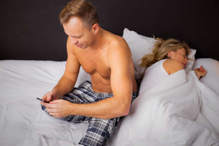 cheater: Woman sleeping and man texting