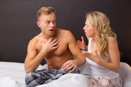 no problems: Couple having an argument in bedroom