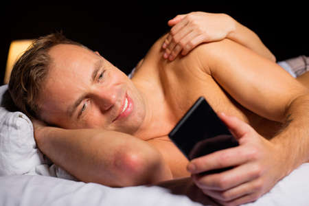 cheating woman: Man cheating while sleeping with woman Stock Photo