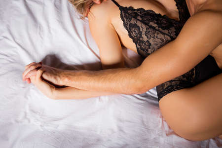 female sex: Sensual couple holding hands Stock Photo