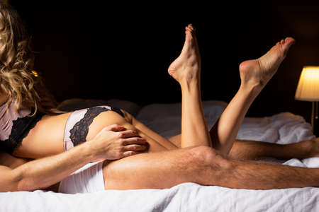 romance sex: Couple having sex in bedroom Stock Photo