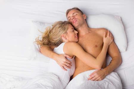 wife: Happy couple sleeping Stock Photo
