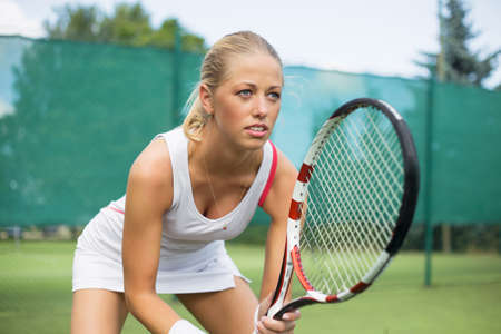 professional woman: Portrait of tennis player on the court