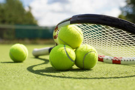 grass: Tennis balls and racket on the grass court