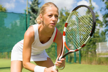 young adult woman: Woman in tennis practice