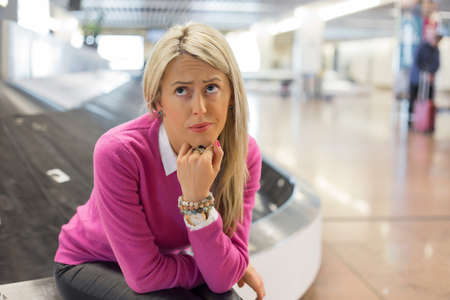 Frustrated woman lost her luggage in airport