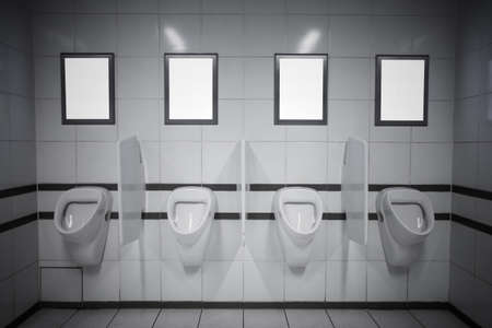 Empty advertisement frames in public toilet