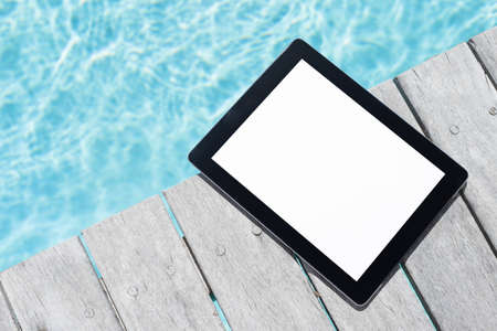 photo backgrounds: Tablet computer by the pool