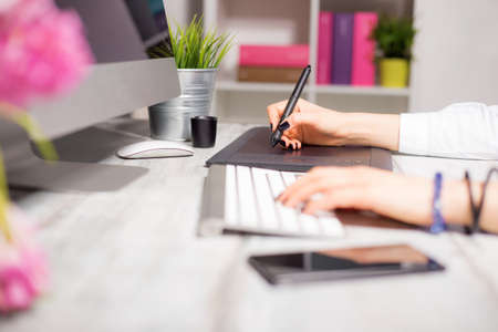 drawing pad: Female working on computer and drawing pad Stock Photo
