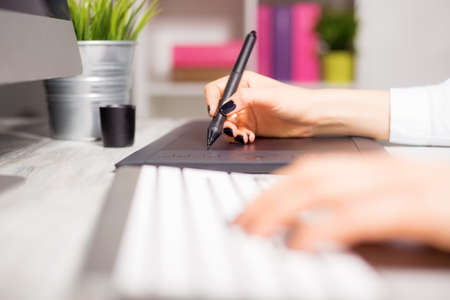 drawing pad: Female working on her drawing pad