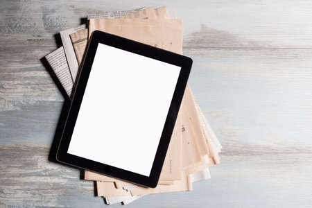 digital world: New tablet and newspapers Stock Photo