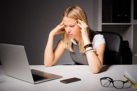 focus: Business woman looking at laptop