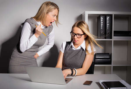 anger management: Female boss about to kill her employee with pencil
