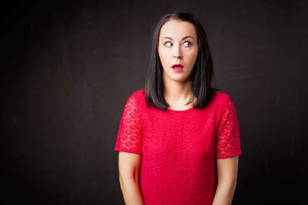 adult oops: Woman looking guilty Stock Photo