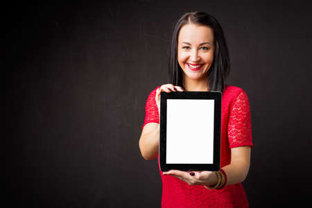 portable: Woman holding portable device Stock Photo