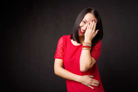 embarrassment: Woman covering her face in embarrassment