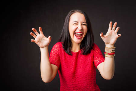 humorous: Woman showing scary face Stock Photo