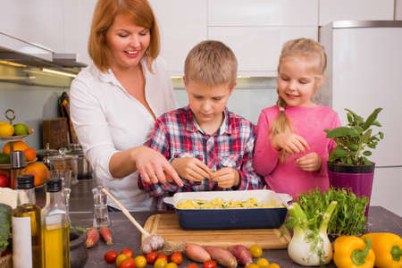 Family having fun cooking in kitchen
