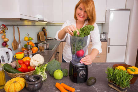 blending: Woman blending vegetables