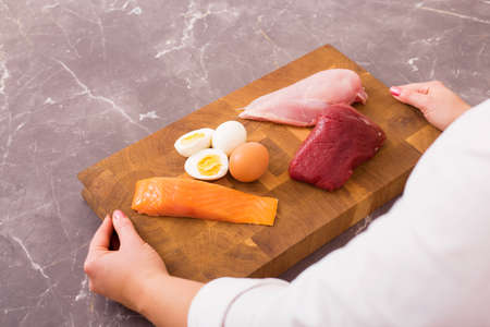 raw chicken: Woman getting ready to prepare nutritious dinner