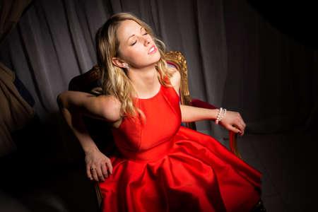 flyaway: Sensual woman sitting in fancy chair