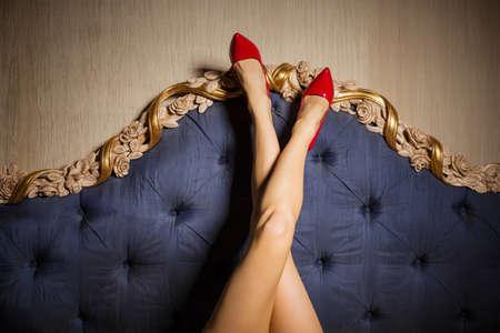 Sexy legs against beds backboard