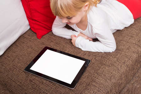 viewing: Little girl using portable device