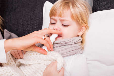 hot cold: Child using medicine to treat cold