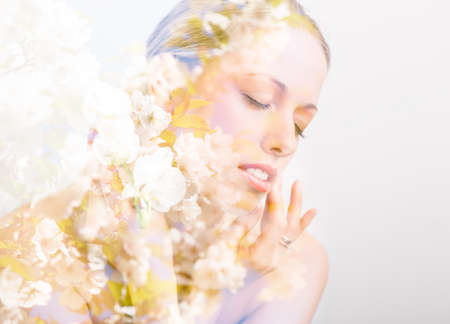 multiple exposure: Double exposure photo of beautiful womans face and flowers