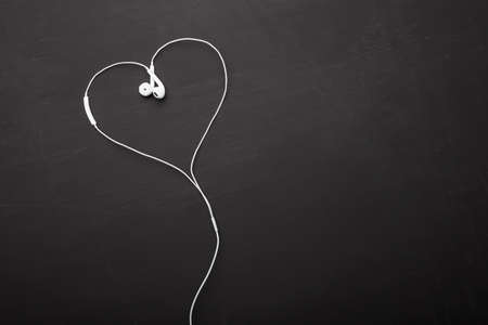 electronic background: Headphones in heart shape
