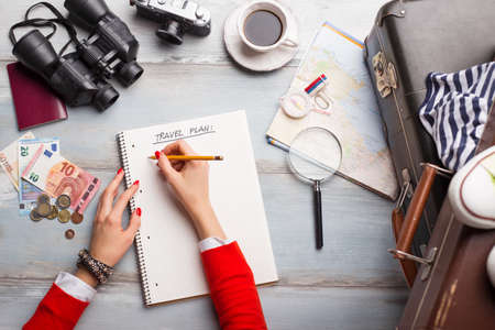 Woman making list for traveling