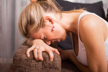 desperate face: Woman in menstrual pain Stock Photo