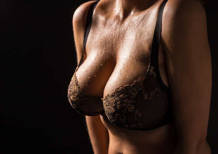 tits: Woman wearing black bra Stock Photo