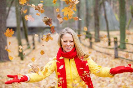 autumn leafs: Woman throwing autumn leafs in the air