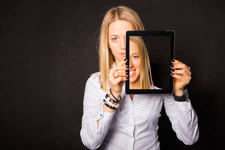 Woman standing with tablet in her hands